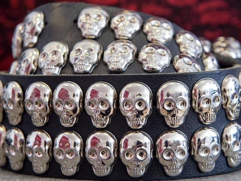 A belt with skull motives arranged at the exhibition Buy now, die later! in Kassel, Germany. (AP Photo/Jens Meyer)