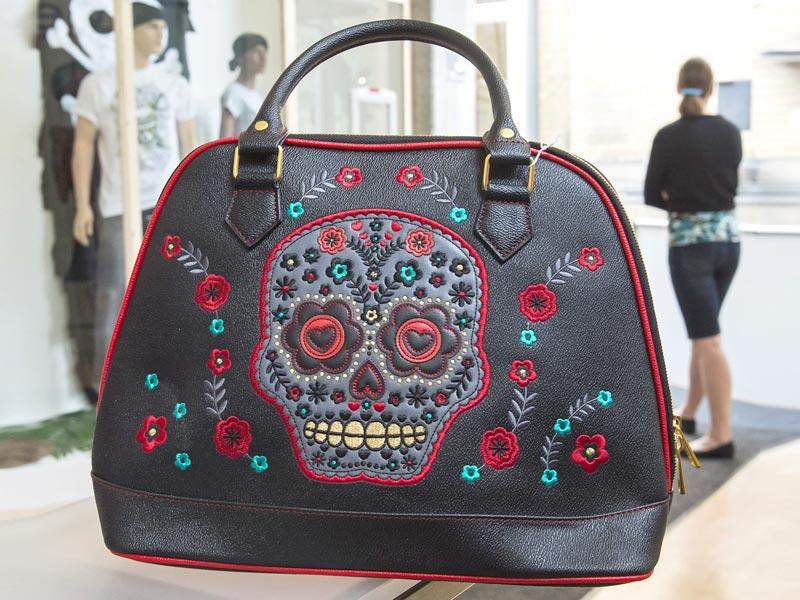 Skull motiffs adorn a handbag at the Buy now, die later! exhibition in the Sepuchral Store. (AP Photo/Jens Meyer)