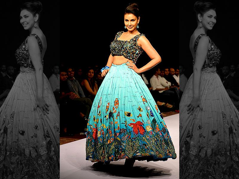 Add a pop of colour this festive season with floral skirts in vibrant hues. Actor and model Lisa Ray looks absolutely stunning in this ensemble by designer Riya Kodali at the Bangalore Fashion Week 2015 in Bangalore on July 24, 2015. (AFP Photo/ Manjunath Kiran)