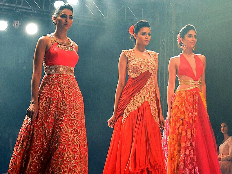 Experiment with flares. Unicoloured, flared gowns with sequins look elegant yet sensuous. (AFP Photo/ Manjunath Kiran)