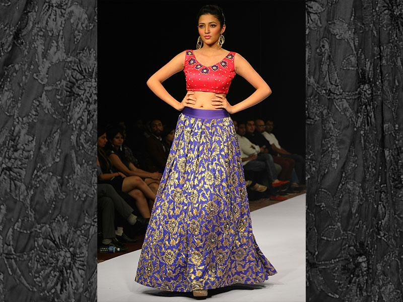 Go ethnic with brocade. Team up a choli with a brocade skirt of contrast colour. (AFP Photo/ Manjunath Kiran)