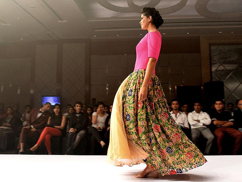 Pair a vibrant top with a mute coloured skirt. Go for floral patterns to enhance the effect. (AFP Photo/ Manjunath Kiran)