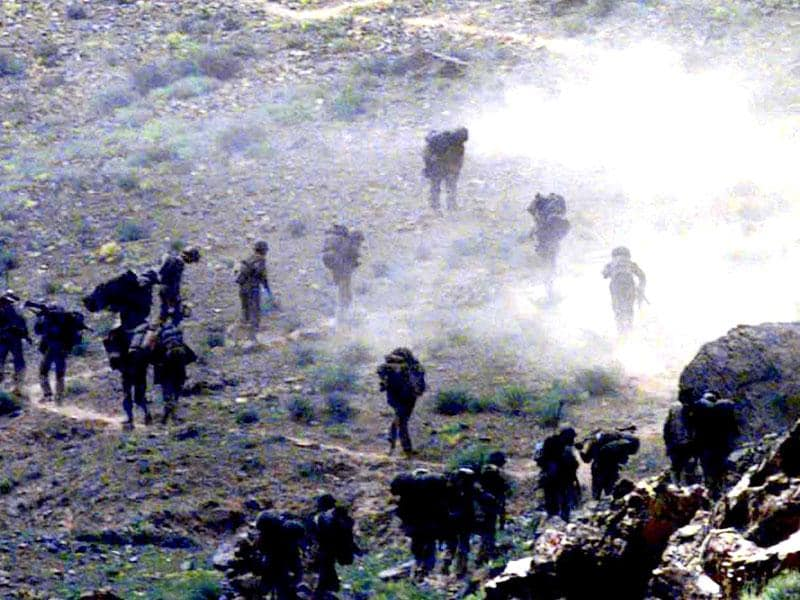Braving the enemy's shells and hostile terrain ,Indian troops   moving forward in  Mushkoh Valley. HT photo  Manish Swarup