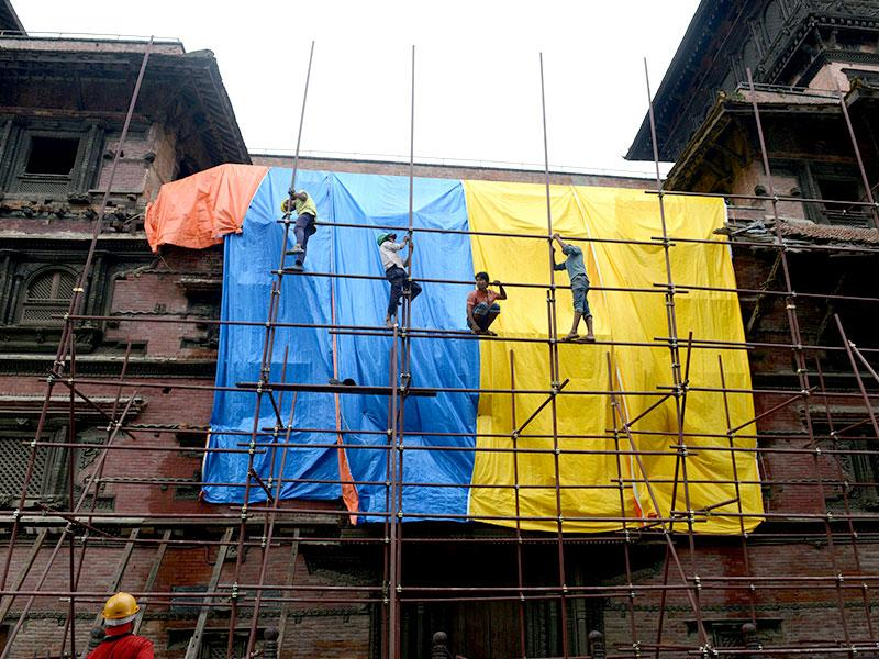 Workers renovate heritage sites in Basantapur Durbar Square that were destroyed by a devastating earthquake in Kathmandu. The World Bank announced in June 2015 that it will provide up to $500 million for reconstruction in Nepal. (AFP Photo)