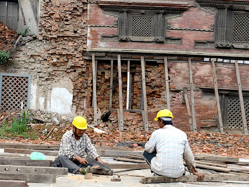 Construction workers in Basantapur Durbar Square renovate a heritage site in quake-hit Kathmandu. (AFP Photo)