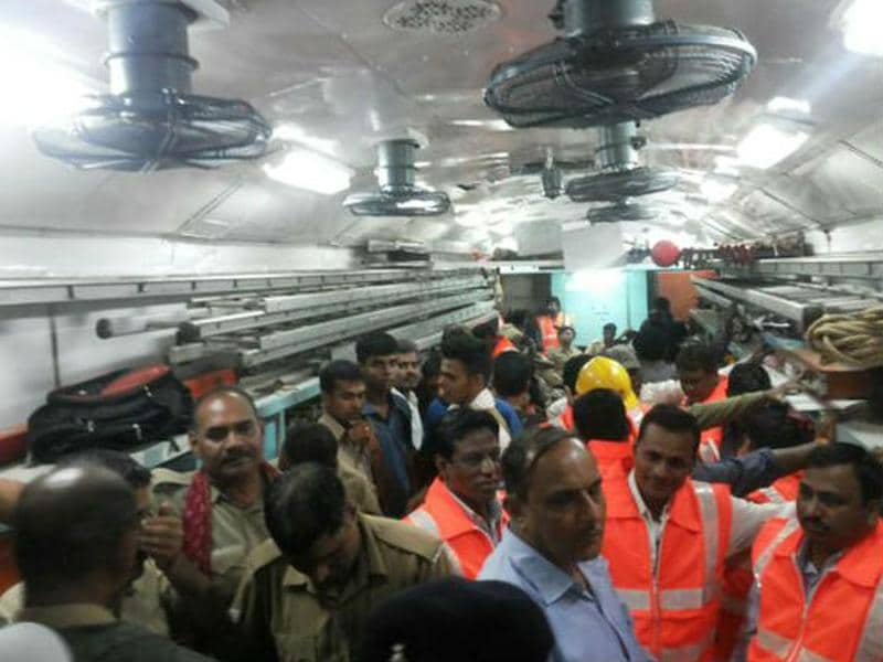 NDRF officials and rescue workers inside a train compartment that derailed near Harda town in Madhya Pradesh. (ANI Photo)