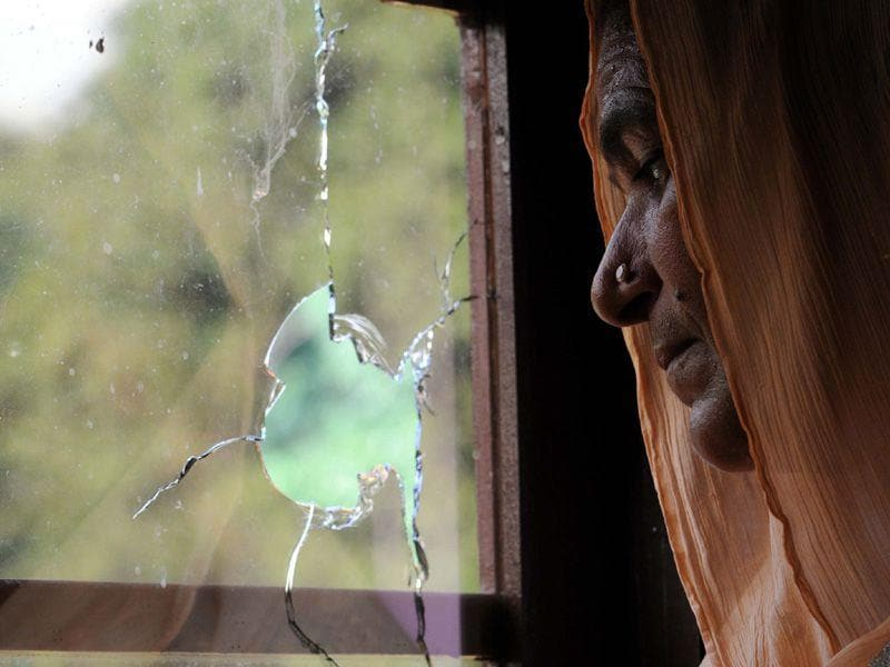 A villager standing near broken glass during heavy shelling from Pakistan side at India-Pakistan International border in Jammu at Pargwal sector, Akhnoor, on Tuesdaya. One civillian died and one BSf soldier injured in firing.(Photo by Nitin Kanotra / Hindustan Times)