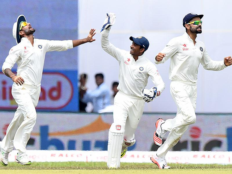 Dhawan (L), Saha (C) and Kohli celebrate the dismissal of Kaushal Silva. (AFP Photo)