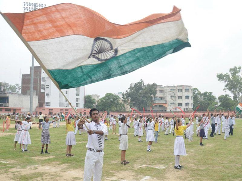 A student holds the tricolor during a rehearsal for Independence Day Prade celebration at Guru Nanak Stadium in Amritsar on Wednesday. (Sameer Sehgal/HT Photo)
