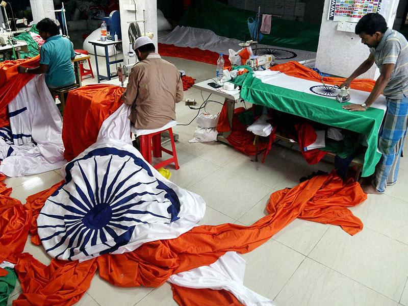 Workers stitching the Indian national flag at a workshop in Bhiwandi near Mumbai on Tuesday ahead of the Independence Day function.(PTI photo)