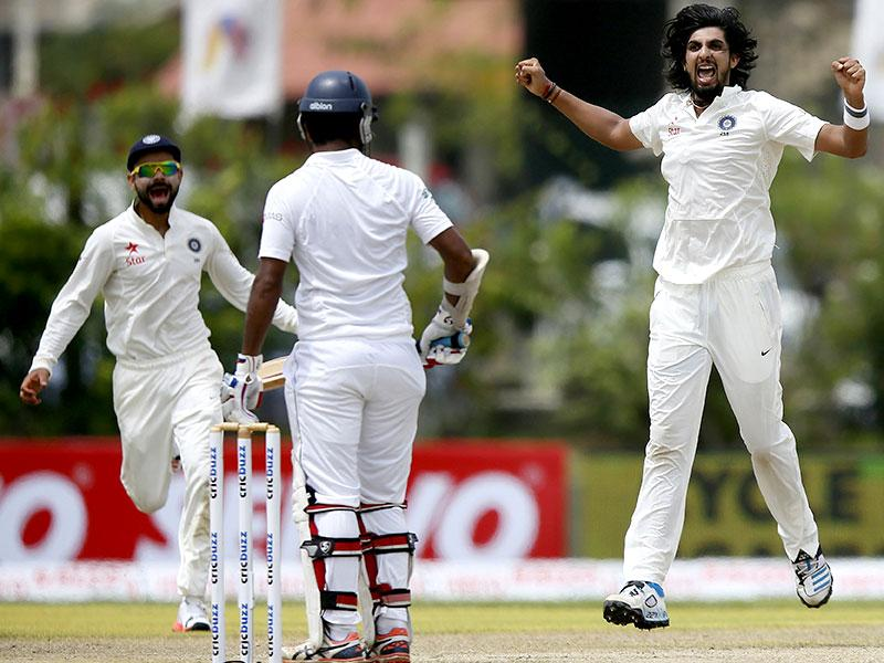 Ishant Sharma, right, celebrates the wicket of Dimuth Karunaratne. (Reuters Photo)