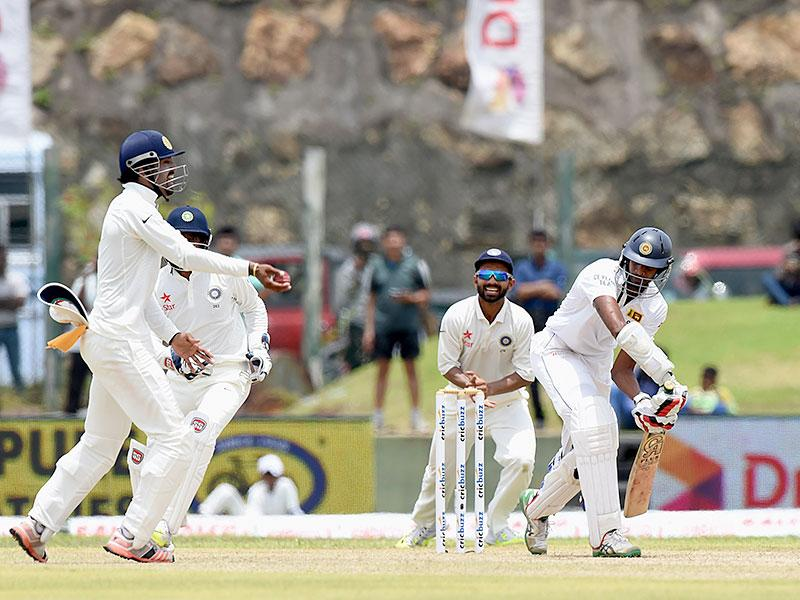 Kohli, right, and fielders Lokesh Rahul, left, and Rahane, centre, celebrate the dismissal of Sri Lankan batsman Jehan Mubarak. (AFP Photo)