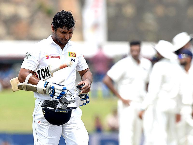 Kumar Sangakkara walks back to the pavilion after his dismissal. (AFP Photo)