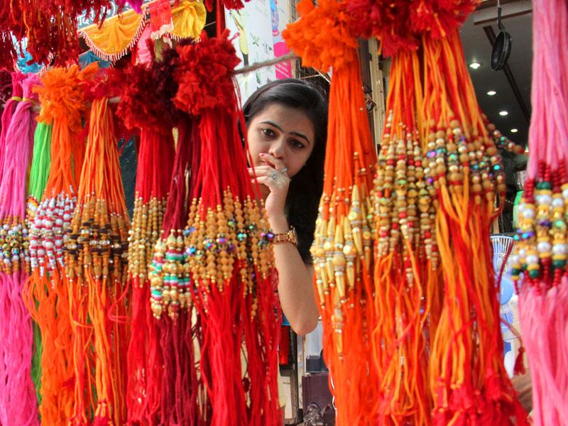 A girl buying rakhis ahead of Raksha Bandhan, in Mumbai. (Pramod Thakur/HT photo)