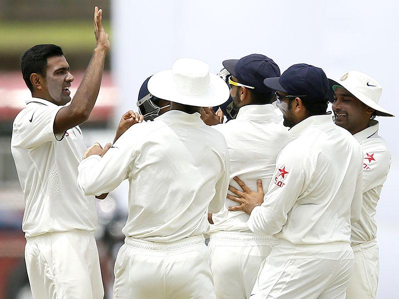 Off-spinner Ravichandran Ashwin, left, celebrates after taking the wicket of Sri Lanka's Kumar Sangakkara on Day 1 of the first Test match in Galle, on August 12, 2015. (Reuters Photo)