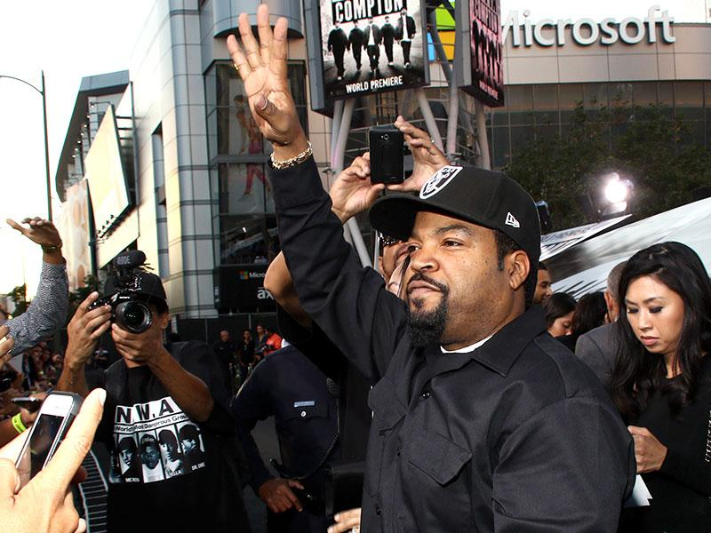Ice Cube waves to his fans at the Los Angeles premiere of Straight Outta Compton, the NWA biopic. (AP Photo)