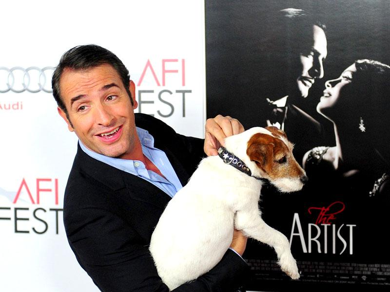 Jean Dujardin posing with Uggie the dog on arrival for the Gala screening of The Artist at Grauman's Chinese Theater in Hollywood, California. AFP Photo