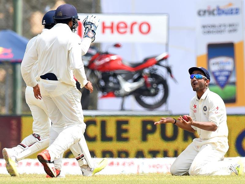 Ajinkya Rahane, right, celebrates the dismissal of Lahiru Thirimanne. Rahane created history on Day 3 by becoming the first player to take eight catches in a Test match. (AFP Photo)