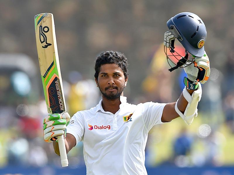 Sri Lanka's Dinesh Chandimal celebrates scoring his century on Day 3 of the first Test match against India at the Galle International Cricket Stadium, in Galle, Sri Lanka, on August 14, 2015. (AFP Photo)