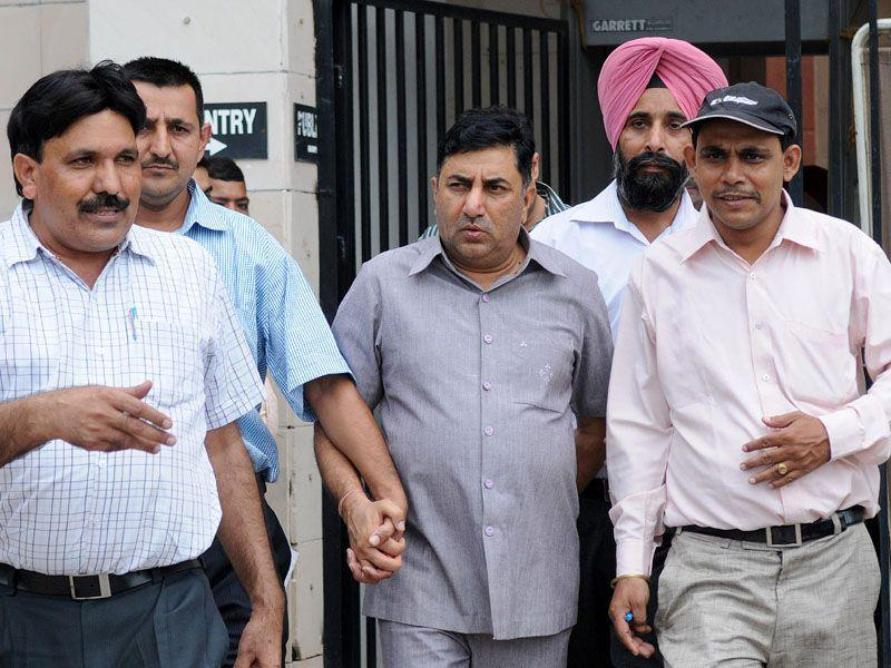 Bribe accused DSP RC Meena coming out after being produced before a Court in Sec 43, Chandigarh on Friday. (HT Photo)