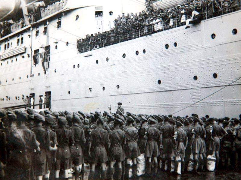 In this picture taken 17 August 1945, Governor General Lord Louis Mountbatten (C) delivers an address to soldiers from The Royal Norfolk Regiment on the quayside in Mumbai, as they prepare to embark on the SS Georgic bound for Britain, the first British Army unit to leave Indian soil after the country achieved independence. (AFP Photo)