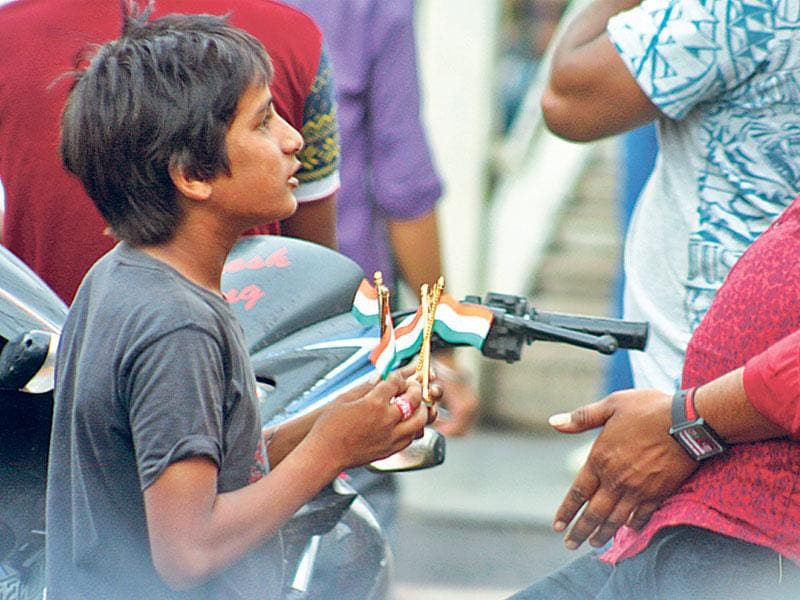 A child selling Indian flags on the eve of Independence Day in Bhopal on Friday. (Bidesh Manna/HT photo)