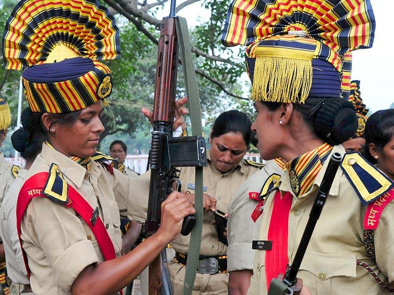Members of the women police contingent checking their weapons during the full dress rehearsal of Independence Day parade at Motilal Nehru Stadium in Bhopal on Thursday. (HT Photo/Mujeeb Faruqui)