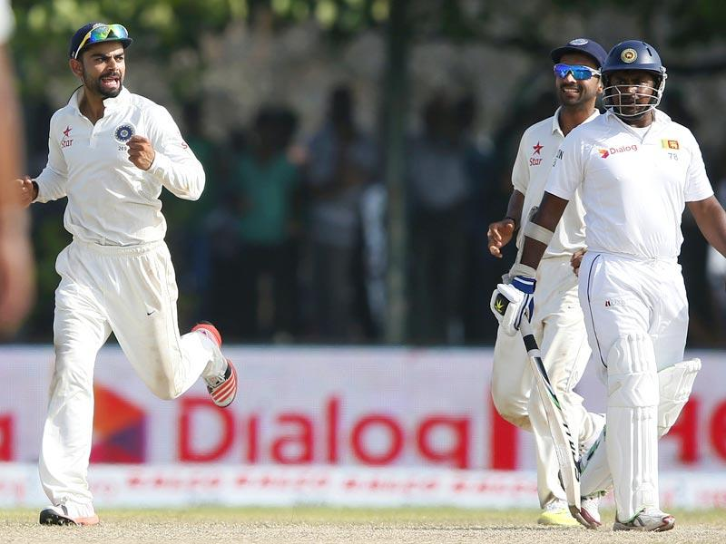 India's Test captain Virat Kohli, left, and Ajinkya Rahane, centre, celebrate the dismissal of Sri Lanka's Rangana Herath on Day 3 of of the first Test in Galle, on August 14, 2015. (Reuters Photo)