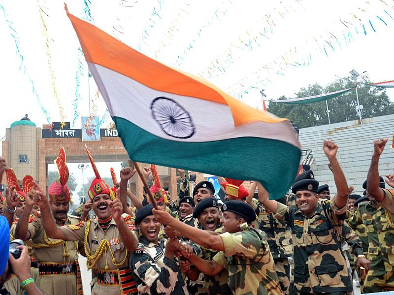 Border security Force (BSF) jawans dancing during the Independence Day celebrations at Attari Border in Amritsar. (Sameer Sehgal/HT Photo)