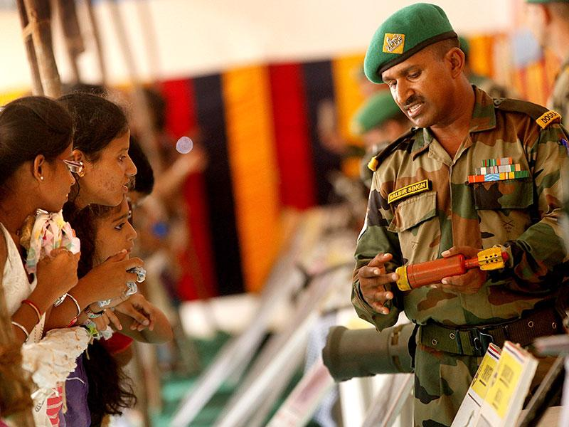 An Indian Army personnel interacts with students at an exhibition of defence equipments, at Ghatkopar on Independence Day. (Arijit Sen/HT photo)