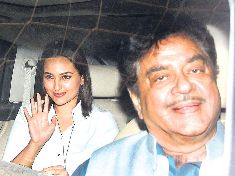 Actor and MP Shatrughan Sinha enters the venue for Brothers' special screening with his daughter Sonakshi Sinha. (Photo: Yogen Shah)