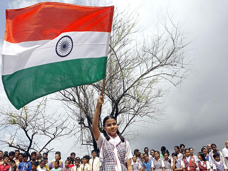 A school student waves the tricolour during Independence Day celebrations, at Bandra's Carter Road in Mumbai.(Pratham Gokhale/HT photo)
