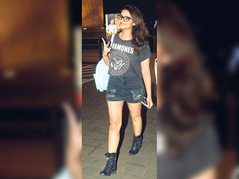 Some leg show: Have a house party to attend? Distressed shorts, casual tee, summer boots teamed with specs — actor Parineeti Chopra's look is perfect for it. (HT Photo/ Yogen Shah)