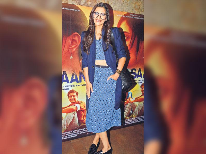 Separate way: Actor Sonam Kapoor charms with her oversized glasses. She wears it stylishly with a long jacket over printed separates, ideal for a casual night out. (HT Photo/ Yogen Shah)