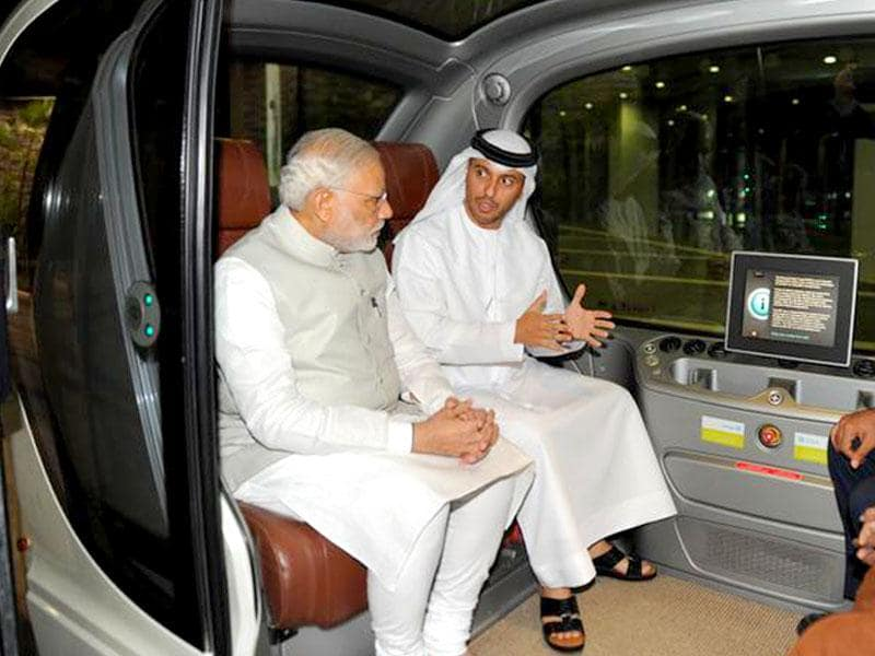 Prime Minister Narendra Modi sits inside an automatic car during his visit to Masdar city on the second day of his two-day visit to the UAE, in Abu Dhabi. (Image via Twitter, @narendramodi)