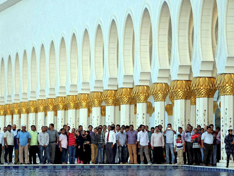 Indian expatriates wait in the courtyard of the Sheikh Zayed Grand Mosque to see their Prime Minister, Narendra Modi. There are nearly 2.6 million Indians in the UAE, constituting 30% of the total population. (AP/PTI Photo)