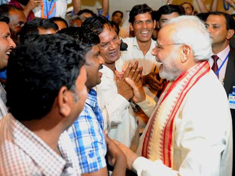 Narendra Modi visited the ICAD Residential City where he interacted with Indian migrant labourers and discussed their working conditions. (Image via Twitter, @narendramodi)