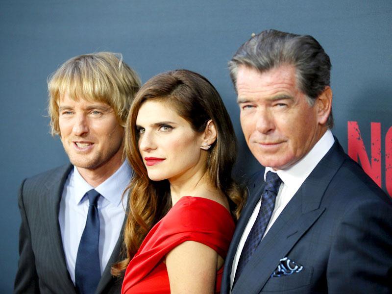 Cast members Owen Wilson (L), Lake Bell (C) and Pierce Brosnan (R) pose at the premiere of the film No Escape, in Los Angeles, California. (Reuters/Danny Moloshok)