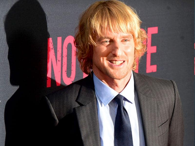 Owen Wilson poses on arrival for the Los Angeles premiere of the film No Escape in Los Angeles. (AFP photo / Frederic J. Brown)