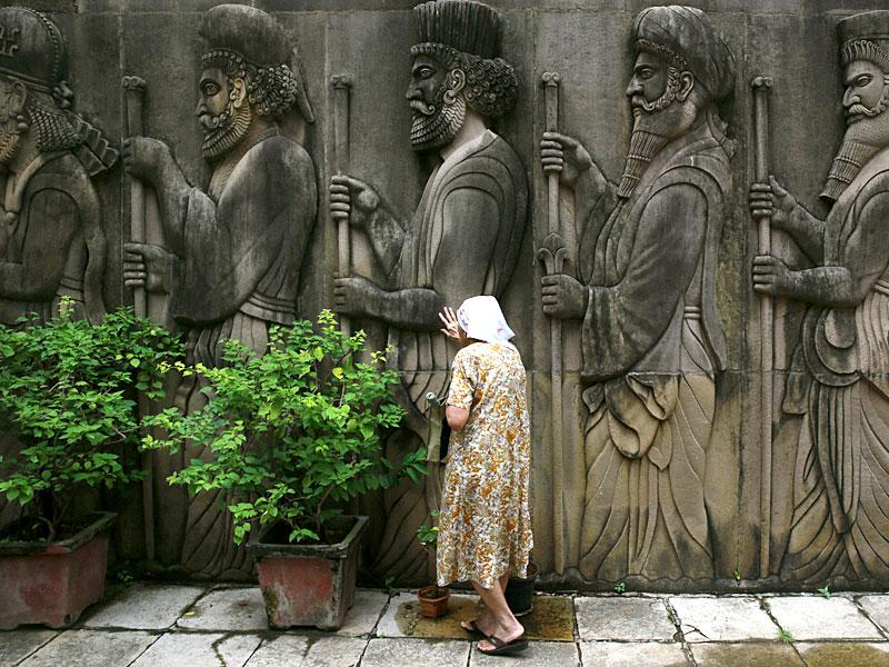 A Parsi woman prays near bas-relief of ancient priests at a Fire Temple on 'Navroz'. Parsis, also known as Zoroastrians, worship fire and are followers of the Bronze Age Persian prophet Zarathustra. (AP Photo)