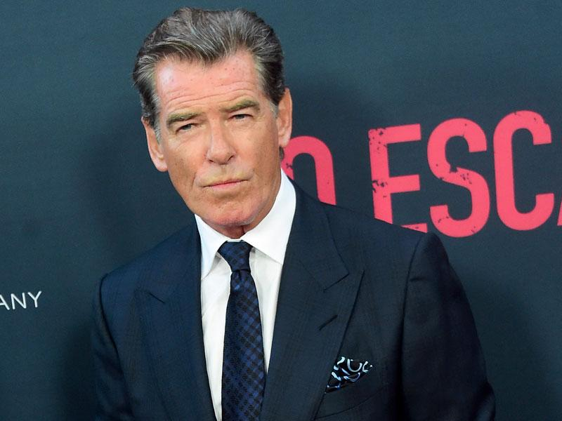 Pierce Brosnan poses on arrival for the Los Angeles premiere of the film No Escape. The film opens in theaters on August 26th. (AFP photo / Frederic J. Brown)