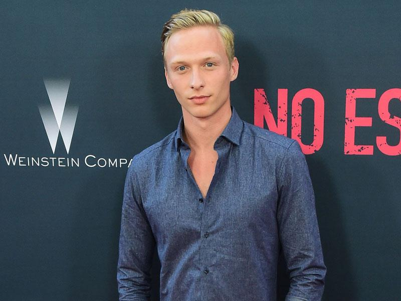 Will Tudor poses on arrival for the Los Angeles premiere of the film No Escape. (AFP photo / Frederic J. Brown)