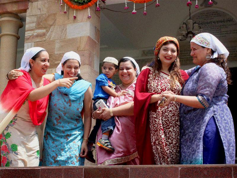 Women of Parsi community greet each other on the occasion of their New Year 'Navroz' in Nagpur, Maharashtra, on Tuesday. (PTI Photo)