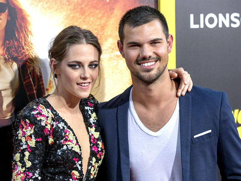 Bella and Jacob reunite as Kristen Stewart poses with Taylor Lautner at the premiere of American Ultra in Los Angeles. (Reuters)