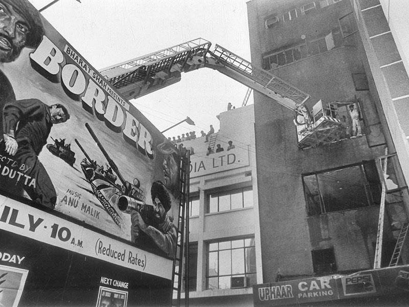 A major fire broke out in South Delhi's Uphaar Cinema on June 13, 1997. Firefighters and locals rescued many trapped inside, but 59 died due to asphyxiation, while over 100 were injured. (PTI file photo)