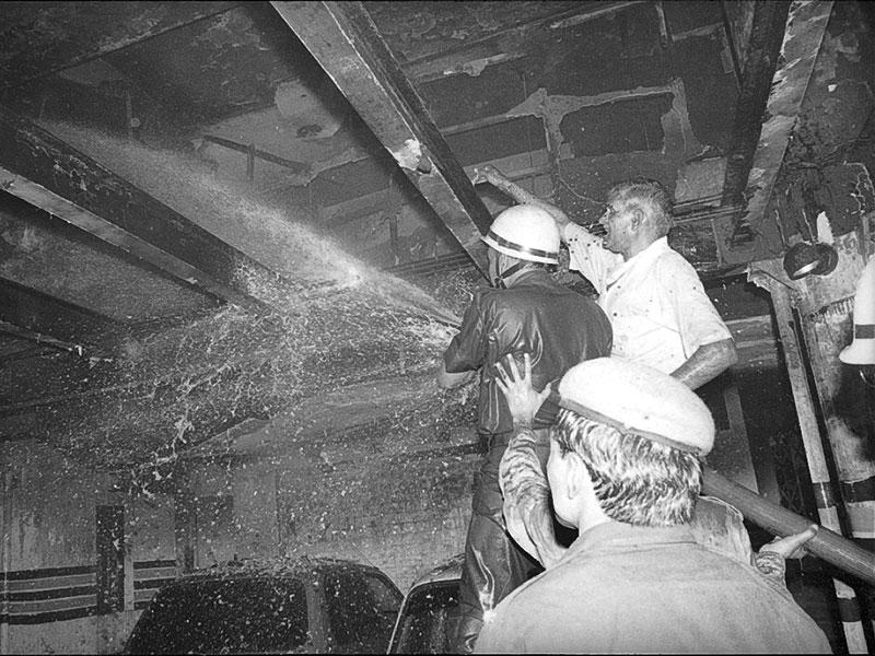 Firefighters trying to douse fire that broke out at the Uphaar Cinema on June 13, 1997. The fire accident took away 59 lives and over 100 were injured. (HT file photo/Prakash Singh)