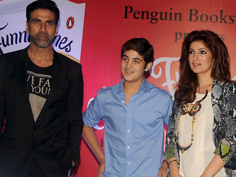 Akshay Kumar, Twinkle Khanna, and Khanna's son Aarav Bhatia pose for a photograph during the launch of the 'Miss Funnybones' book written by Khanna in Mumbai on late August 18, 2015. (AFP Photo)