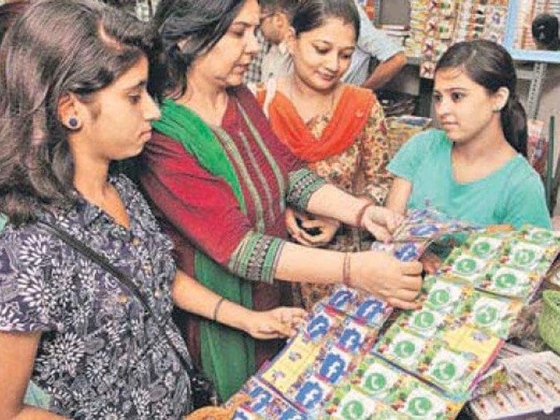Women and girls buying rakhis with Facebook and WhatsApp themes at Attari Bazaar in Jalandhar. (HT Photo)