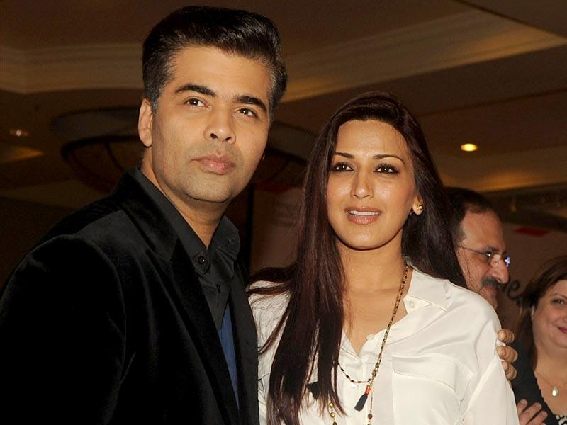 Karan Johar poses with Sonali Bendre during the launch of the 'Miss Funnybones' book written by actress, columnist and interior designer Twinkle Khanna in Mumbai on late August 18, 2015. (AFP Photo)