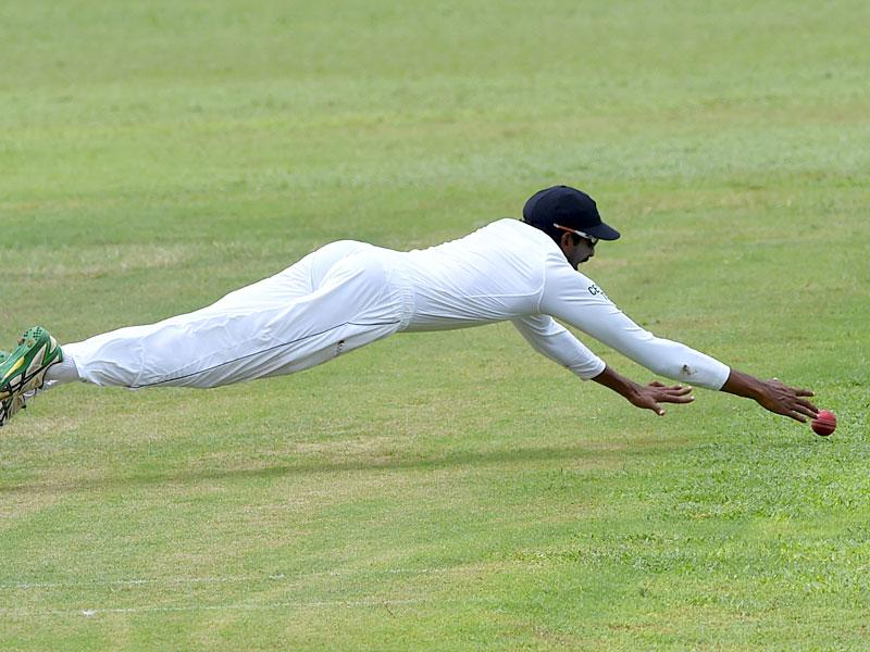Sri Lanka's Jehan Mubarak dives as he unsuccessfully attempts to stop the ball. (AFP Photo)